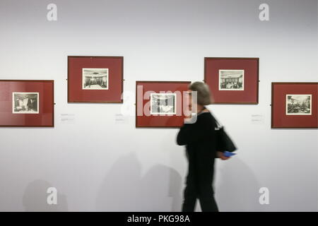 Moscow, Russia. 13th Sep, 2018. MOSCOW, RUSSIA - SEPTEMBER 13, 2018: A visitor looks at photographs of yachts by Jean Geiser during an exhibition titled 'The Romanovs: Family Chronicles' at New Tretyakov Gallery at Krymsky Val; the exhibition includes photographs of three Russian tsars: Alexander II, Alexander III, and Nicholas II, between the 1870s and 1914. Alexander Shcherbak/TASS Credit: ITAR-TASS News Agency/Alamy Live News - Stock Photo