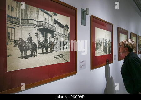 MOSCOW, RUSSIA - SEPTEMBER 13, 2018: A photograph by Polish photographer Konrad Brandel, captioned 'Spala, Empress Maria Feodorovna leaving the palace' (front), at an exhibition titled 'The Romanovs: Family Chronicles' at New Tretyakov Gallery at Krymsky Val; the exhibition includes photographs made during the reign of three Russian tsars: Alexander II, Alexander III, and Nicholas II, between the 1870s and 1914. Alexander Shcherbak/TASS - Stock Photo