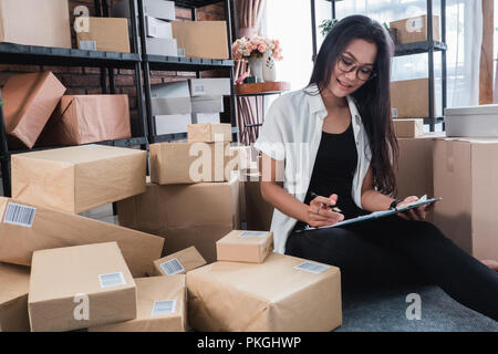 working at home and check shipping packages - Stock Photo