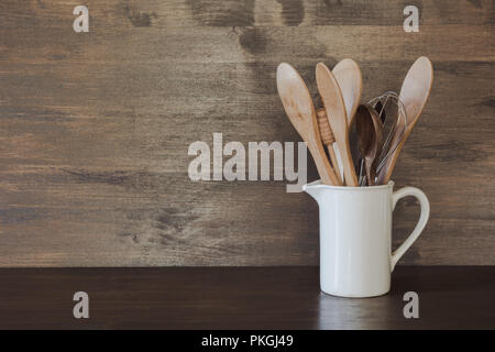 Crockery, clayware, white utensils and other different stuff on wooden tabletop. Kitchen still life as background for design. Copy space. - Stock Photo