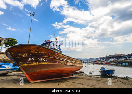 A small fishing boat tied up in Cambarro - Galicia, Spain - Stock Photo