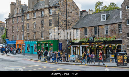 EDINBURGH SCOTLAND CANDLEMAKER ROW THE GREYFRIARS BOBBY STATUE AND TOURISTS - Stock Photo