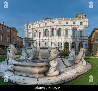 fountain in the old square with background of the carrara bergamo library - Stock Photo