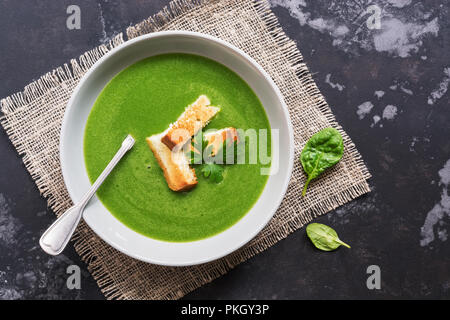 Soup cream with spinach. Green vegetarian vegetable soup puree. Flat lay,top view. - Stock Photo