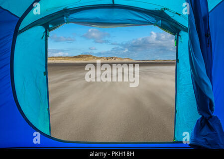 View from inside a tent onto a beach in Texel, the Netherlands. - Stock Photo