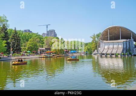 Dnipro, Ukraine - May 05, 2018: A view of an artificial lake with an open-air theater in the city's central park - Stock Photo