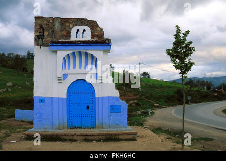 Decorative door at the exit of Chefchaouen, a very touristic town in Morocco - Stock Photo