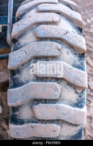 Tread shown on a tire of a tractor - Stock Photo
