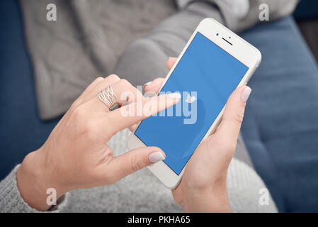 Kyiv, Ukraine - January 24, 2018: Female Holding Apple Iphone 8 plus On Hand And Start Using Twitter Application. - Stock Photo