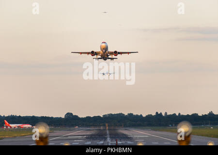 GATWICK AIRPORT, ENGLAND, UK – SEPTEMBER 13 2018: View directly down the runway as an easyJet Airlines plane takes off from Gatwick Airport. - Stock Photo
