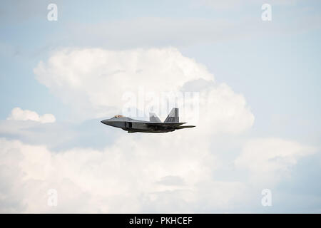 Oshkosh, WI - 28 July 2018:  A F-22 flying with at an airshow. - Stock Photo