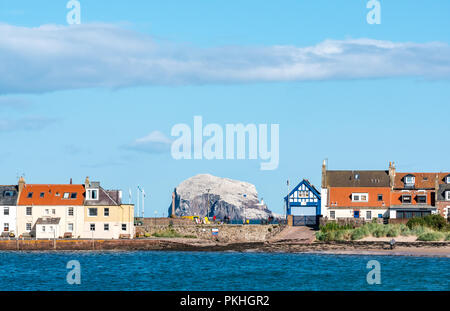View from West Bay to harbour and Bass Rock, North Berwick, East Lothian, Scotland, UK - Stock Photo