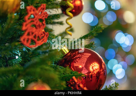 Christmas tree with decorations, christmas balls, light garlands, bokeh. Abstract festive background for design. Selective focus. Winter holiday, Happy New Year, xmas. - Stock Photo
