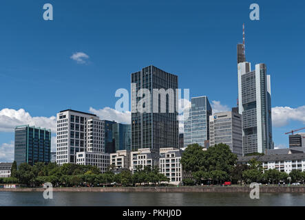 view on the financial district with main river in frankfurt city, hesse, germany. - Stock Photo