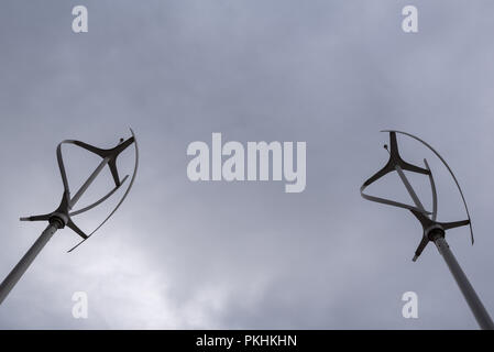 Two wind power generator windmills for clean renewable energy against global warming and climate change - Stock Photo