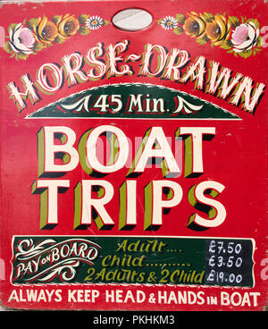 A sign on the Llangollen Canal advertising horse drawn boat trips, Llangollen, Wales, UK - Stock Photo