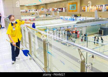 BANGKOK, THAILAND - JAN13, 2017: Cleaning service at work in the Don Mueang International Airport . The airport is the world's oldest international ai - Stock Photo