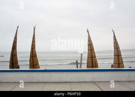 Totora reed boats (balsillas or caballitos) are still actively used for fishing on the beach of Huanchaco. Trujillo region, Peru. Jul 2018 - RF - Stock Photo