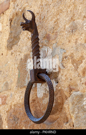 At Pienza (Tuscany - Italy). forged equine wall attachment ring embellished with an animal head representation. - Stock Photo