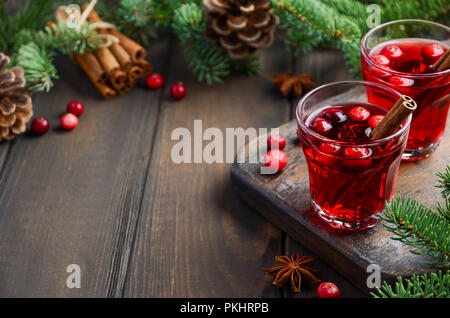 Cranberry Drink on Wooden Background Decorated with Fir Branches, Spices and Fresh Berries, Selective Focus. - Stock Photo