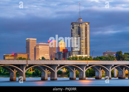 Tulsa, Oklahoma, USA downtown skyline on the Arkansas River at dusk. - Stock Photo