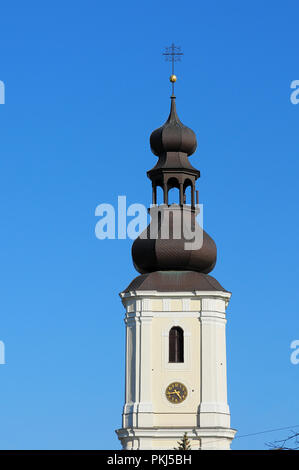 Old Polish catholic church (Church of Sts. Maurice) tower with clock on the clear blue sky. Wroclaw, Poland - Stock Photo
