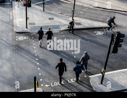 London, England – January 18 2018: Group of people walking on the street of London city early in the morning - Stock Photo