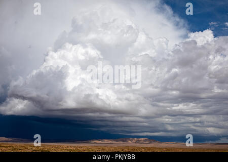Cumulonimbus clouds with a blue sky background - Stock Photo