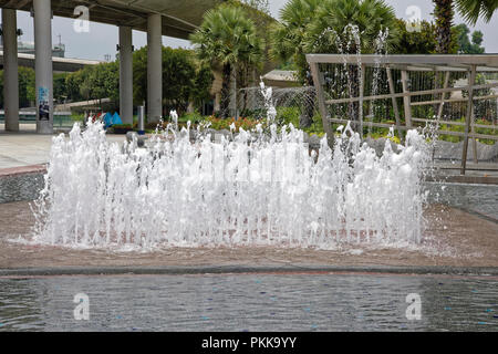 Singapore, Singapore- August 07, 2018: View of the fountain in Marina Barrage - Stock Photo