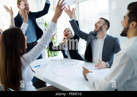 Business people working together on project and brainstorming in office - Stock Photo