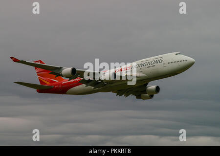Oasis Hong Kong Boeing 747 jet airliner plane. Airline. Jumbo jet aircraft flying. Space for copy - Stock Photo