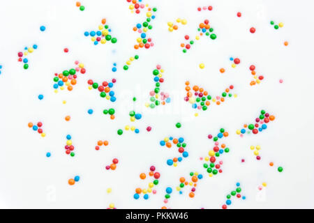 Abstract background from milk white with colored balls - Stock Photo
