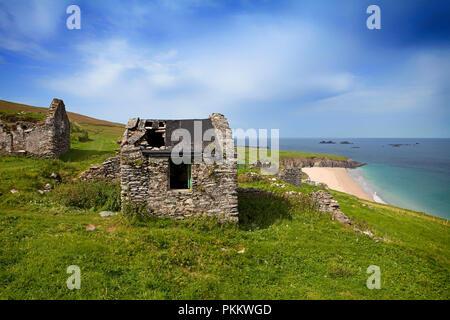 Deserted Cottages on Great Blasket Island, The Blasket Islands, Off Slea Head on the Dingle Peninsula, County Kerry, Ireland - Stock Photo