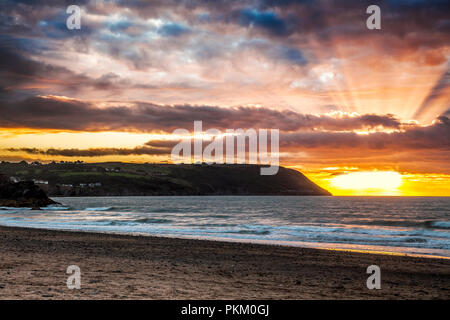 Sunset over Tresaith beach in Ceredigion, Wales, looking towards Aberporth. - Stock Photo