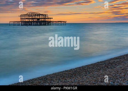 he remains of the Brighton West Pier seen at sunset - Stock Photo