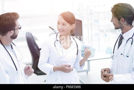 Team of different doctors having conversation - Stock Photo