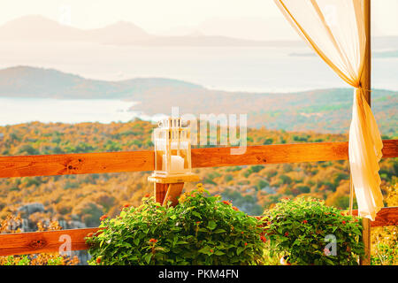 Idyllic sunrise at cafe at Costa Smeralda in Sardinia in Italy. Mediterranean Sea on the background - Stock Photo