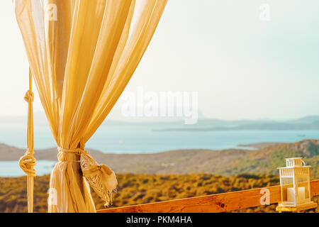 Idyllic sunrise in cafe in Costa Smeralda in Sardinia in Italy. Mediterranean Sea on the background - Stock Photo