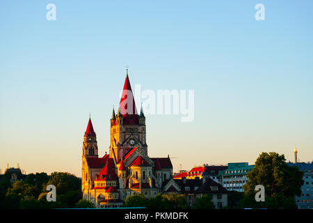 St. Francis of Assisi Church in sunshine and blue sky background in Vienna, Austria. - Stock Photo