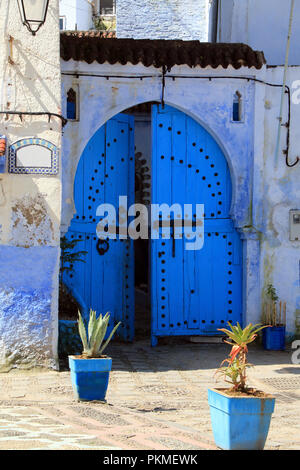 Beautiful old blue wooden gate in the charming Chaouen, one of the most visited towns in Morocco - Stock Photo
