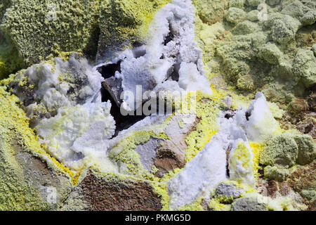 Sulfur fumaroles and chloride crusts on the crater rim, Gran Cratere, Vulcano Island, Aeolian and Lipari Islands, Sicily, Italy - Stock Photo