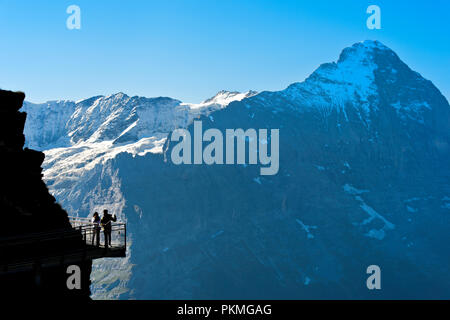 Tourists on the First Cliff Walk by Tissot in front of the Eiger North Face, Grindelwald, Switzerland - Stock Photo