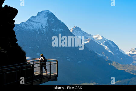 Tourist on the First Cliff Walk by Tissot in front of the Eiger North Face, Grindelwald, Switzerland - Stock Photo