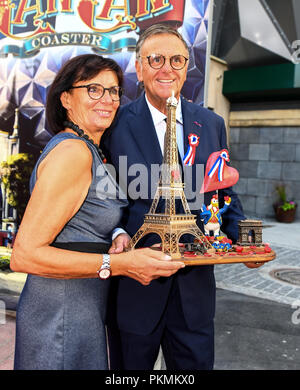 12 September 2018, Baden-Wuerttemberg, Rust: Roland Mack, Managing Director of Europa Park, and his wife standing on the red carpet with a replica of the Eiffel Tower during the opening of the French themed area in Europa Park. Photo: Patrick Seeger/dpa - Stock Photo