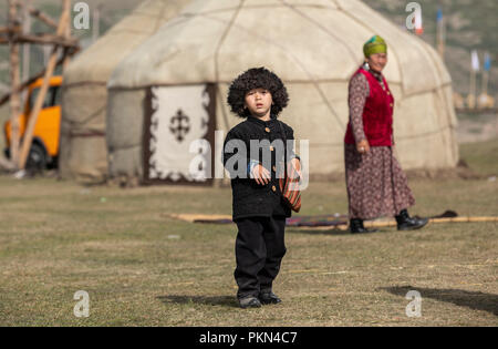 Lake Issyk-Kul, Kurgyzstan, 6th September 2018: local boy in Kyrgyz outfit during World Nomad Games 2018 - Stock Photo