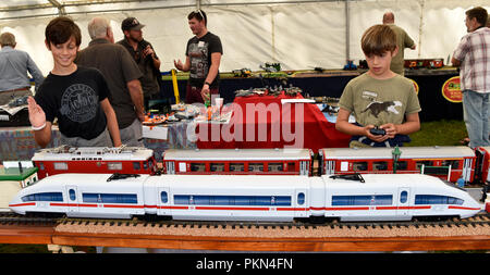 Visitors playing with a miniature railway at a models weekend event, Liphook, Hampshire, UK. 2 September 2018. - Stock Photo