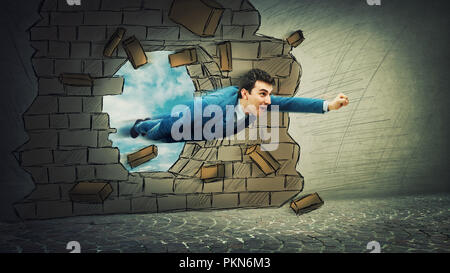 Flying businessman break through wall like a superhero. Business success, opportunity and risk concept. - Stock Photo