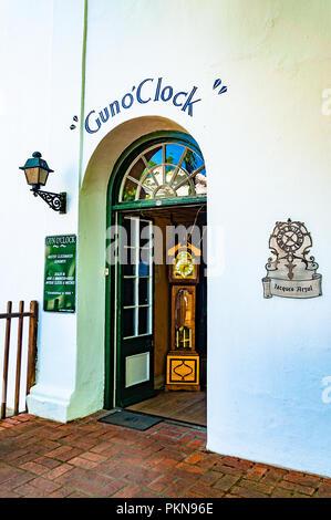 'Gun o'Clock'  shop clock in doorway, master clockmaker, Stellenbosch, South Africa - Stock Photo