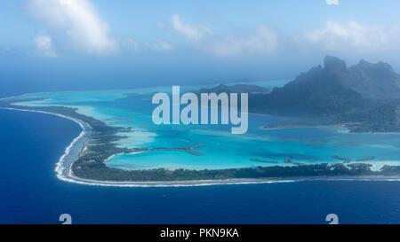 Flying Over Bora Bora's Blue Lagoon In French Polynesia - Stock Photo
