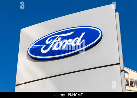 Saint Petersburg, Russia - August 10, 2018: Ford dealership sign against a blue sky - Stock Photo